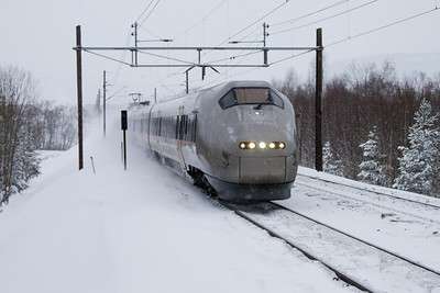Flytoget winter Flytoget BM71 Airport Express train at high speed through the winter landscape