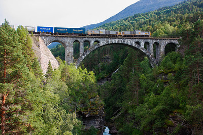 Kylling bridge CargoNet freight train, pulled by two Di8 diesel electric locomotives, on Kylling bridge on the Rauma line towards Åndalsnes