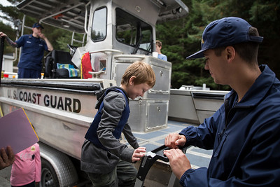 Mathew Osborn-Owen stands up on the Coast Guard Sector Humboldt Bay's small boat.  (Sam Armanino - The Times-Standard)