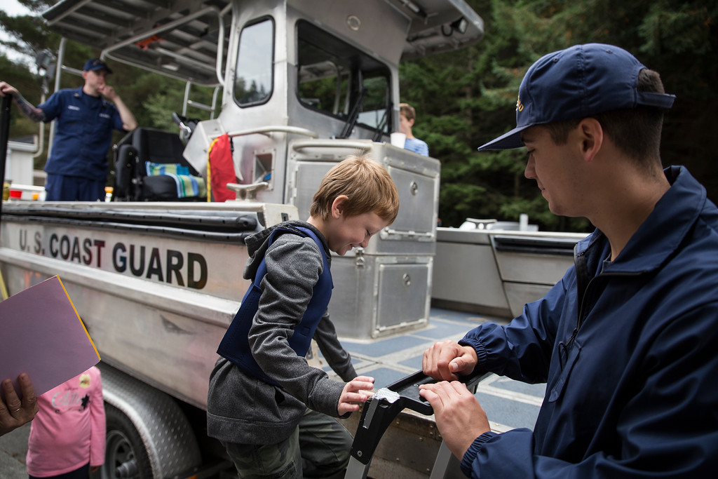 . Mathew Osborn-Owen stands up on the Coast Guard Sector Humboldt Bay\'s small boat.  (Sam Armanino - The Times-Standard)