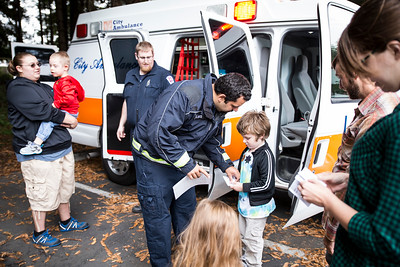 Jack Baker gets a sticker from a City Ambulance operator on Thursday during Glen Paul School's transportation day.  (Sam Armanino - The Times-Standard)