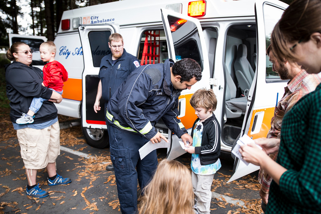 . Jack Baker gets a sticker from a City Ambulance operator on Thursday during Glen Paul School\'s transportation day.  (Sam Armanino - The Times-Standard)