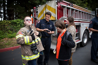 Nine city and county vehicles were opened to Glen Paul students. They got to see a Coast Guard boat, fire truck, ambulance, school bus, mail van, city bus, Caltrans truck during the school's transportation day.   (Sam Armanino - The Times-Standard)