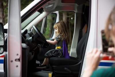 Quinn White, 2, sits in the front seat of a City Ambulance during Glen Paul School's transportation day.  (Sam Armanino - The Times-Standard)