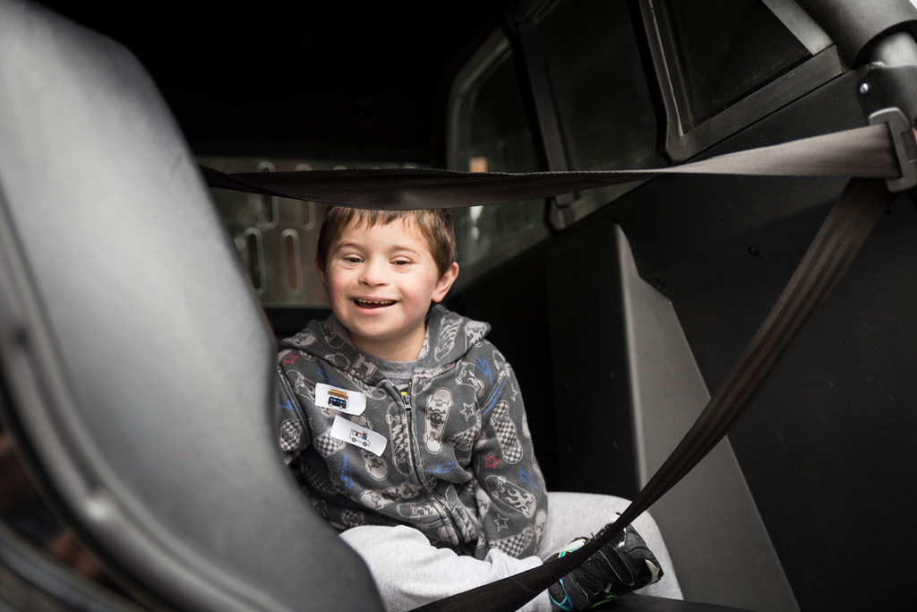 . Tristan Buckman sits in the back of a Eureka Police Department patrol vehicle during Glen Paul school\'s transportation day on Thursday.  (Sam Armanino - The Times-Standard)