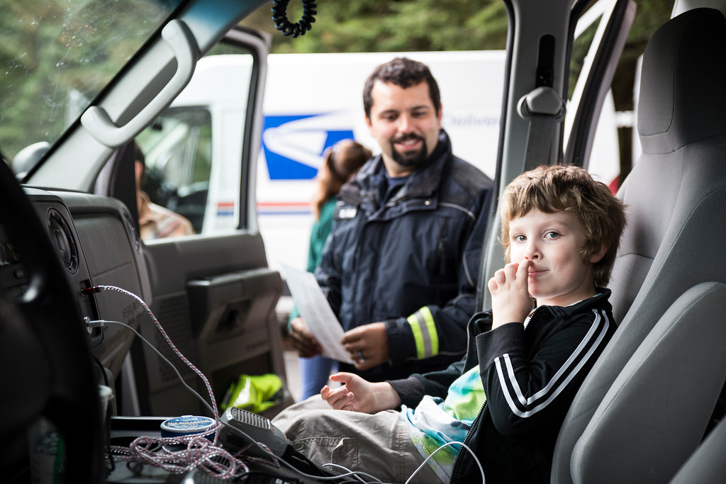 . Jack Baker sits in the front seat of a Eureka city ambulance on Thursday during Glen Paul School\'s transportation day.  (Sam Armanino - The Times-Standard)