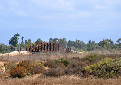 "Teasingly referred to as the ""bridge to nowhere"" when it was first built, this bridge provides an important connection over Placentia Avenue linking the east and west halves of Fairview Park.  Fairview Park has been referred to as the ""Yosemite of Costa Mesa"" due to its natural habitat, wide open spaces, and panoramic views."