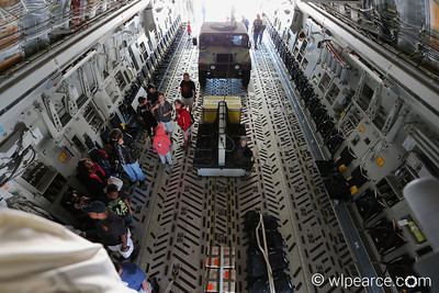 The cavernous cargo bay of a C-17A as seen from the crow's nest above and just behind the cockpit.