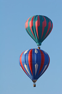 Two Hot Air Balloons one above the other