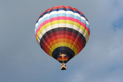 looking up into a hot air balloon with the flame ignited