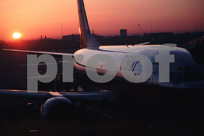 A US Airlines plane ready for departure as the sun sets.
