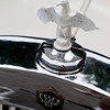 Essex Super Six hood ornament and radiator cap.