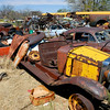 1933 Chevrolet sits decomposing in a desert junkyard in southwestern USA.