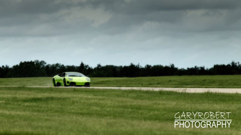 Green Lamborghini Murcielago running the 1/2 mile run at the Chicago WannaGOFAST.com event at the Bult Field Airport in Monee, IL 2013