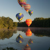 Hot Air Balloons Flaoting Over the River at Dawn