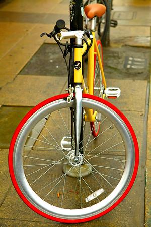 Red & Silver wheel Rider. Venice, CA.