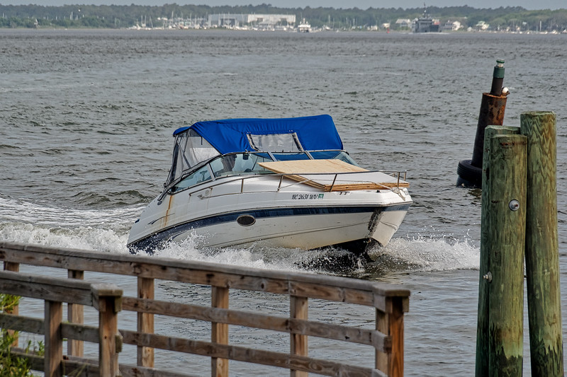 Speed Boat Enters Harbor