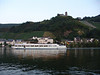 Cruise Ship and Castle on the Mosel in Bernkastel, Germany