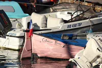 Small Pink Boat moored in Port del la Salis, Antibes, France