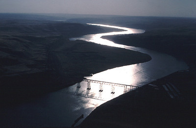 An aerial view at dusk of the railroad bridge over the Snake River in eastern Washington.