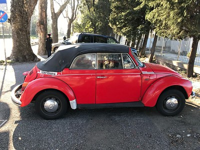 Red Volkswagen Beetle Cabriolet snapped in Trieste, Italy