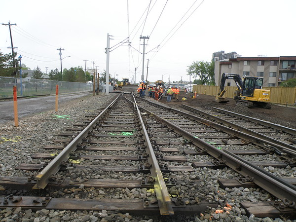 Crews work on removing the wood railway ties original to the Capital Line.
