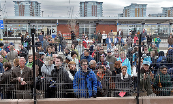 Crowds watch official opening at Century Park LRT.