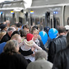 Crowds enter the cars at the Century Park LRT station.