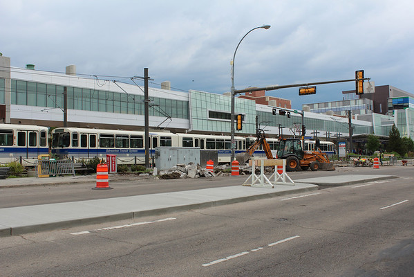 83 Avenue plaza sidewalk construction