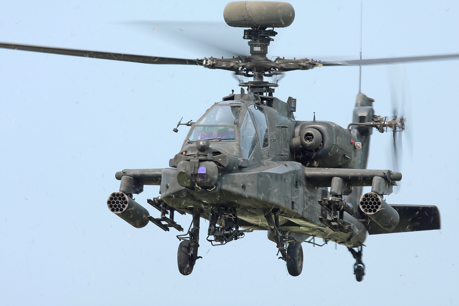 Looking at the front of a hovering Apache Longbow helicopter