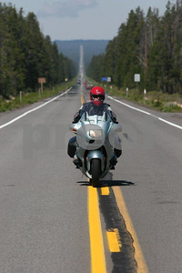 A biker poses for a special picture on the centerline of Highway #138 between Crater Lake National Park and Bend, Oregon.