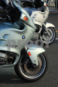 Two BMW bikes, a R1150RT and a R1100RT are parked at the ferry terminal waiting for the ferry.