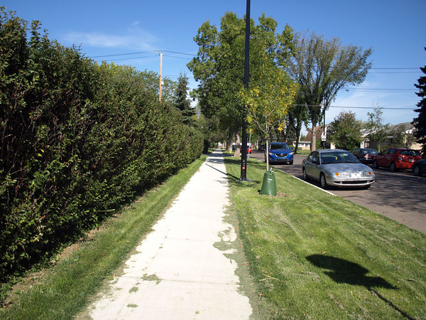 After - New sidewalk at 115 Avenue & 135 Street, facing northwest