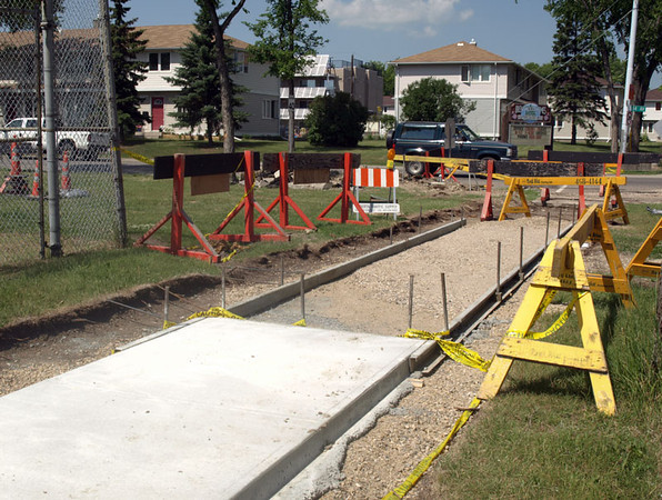 During - Sidewalk construction on 114 Avenue & 135 Street, facing northwest