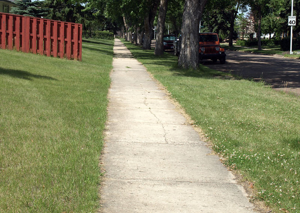 Before - Northwest sidewalk on Woodcroft Avenue & 136 Street