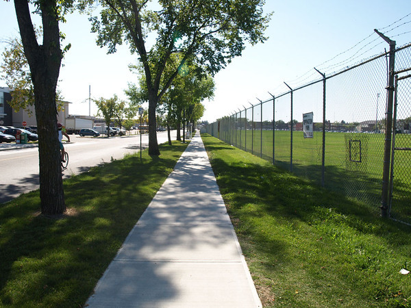 After - New sidewalk at 114 Avenue & 135 Street, facing southwest