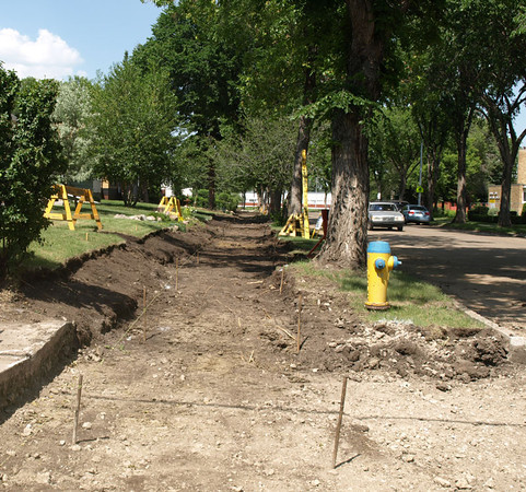 During - Sidewalk construction on 115 Avenue & 135 Street, facing northwest