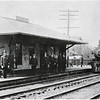"A train pulls into the new passenger station at Monroe Street, Auburn, NY in 1908. The train is  pulled by Engine Number 1. Central's ""Auburn Branch"" tracks are to right of the train. (Photo ID: 38286 b)"