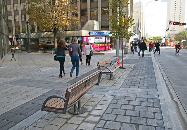 Completed sidewalk along Jasper Avenue.