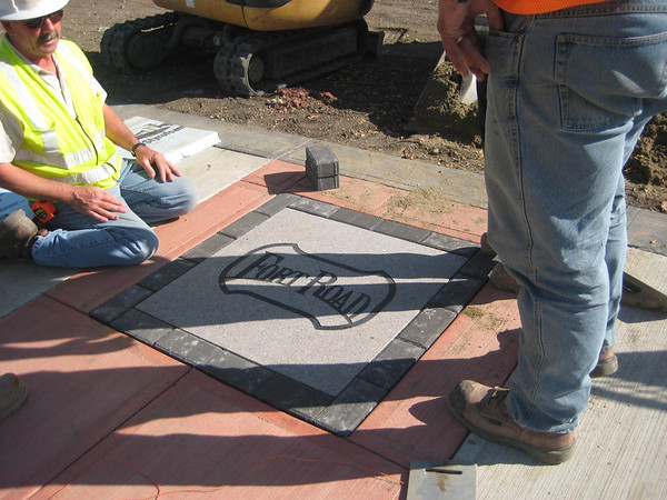 Construction of sidewalk with Fort Road stamp