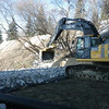 North side: placing rock for armouring berm, March 2013.
