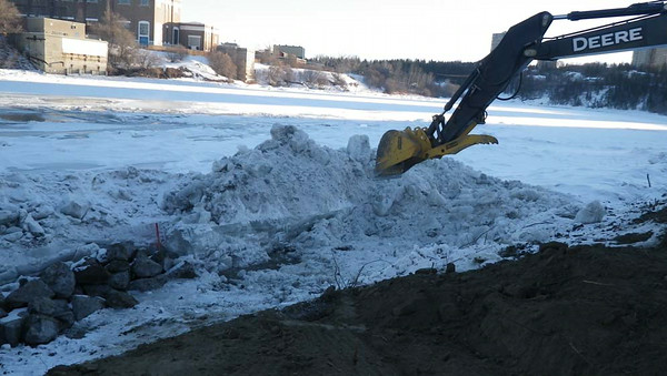 North side: snow, ice removal and placing rock at the toe, February 2013.