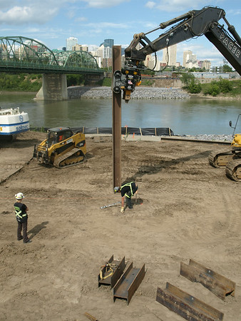 Putting in pilings on south river bank, August 2013.