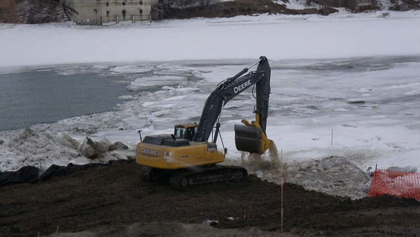 South side: removing ice for clay backfill, February 2013.