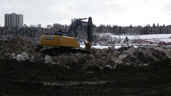 North side: removing and pushing ice/snow towards river, February 2013.