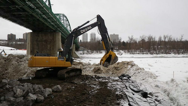 North side: placing rock after removal of ice and slush, February 2013.