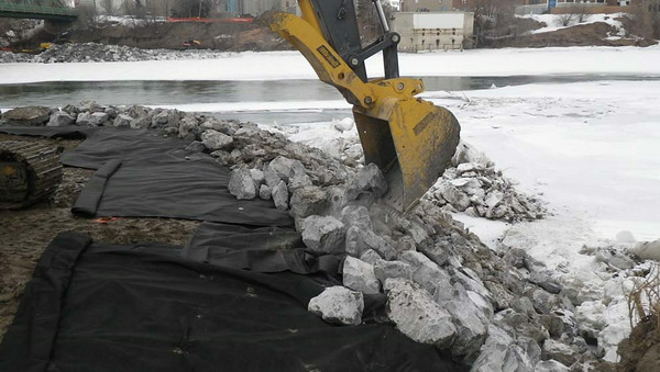 South side: placing rock, February 2013.