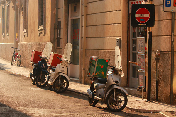 Delivery Scooters ready for an evening of work as the sun sets