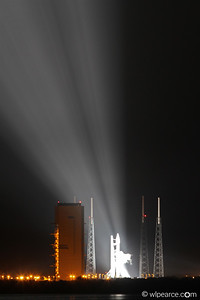 Atlas 5 ready to go.  The four towers are for lightning protection (an unfortunate necessity on this night).  The large building is home.  They ended up rolling the rocket back into the building for Tropical Storm Isaac.