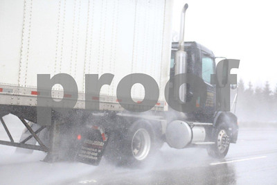 Semi-trucks on I-5 during a rain storm create a challenge for other motorists in Washington State.
